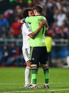 Marcelo celebrates victory with Iker Casillas after the UEFA Champions League final match between Real Madrid CF and Club Atlético de Madrid at Estadio Da Luz on May 24, 2014 in Lisbon, Portugal.