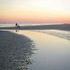 A sunset bike ride on the beach. One of the many fun vacation activities to partake in when you visit Hilton Head!