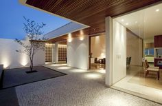 """This contemporary home by Mustafá Bucar Arquitetura is located in Goiânia, Goiás, Brazil. One highlight of this 2008 project is the decorative tile motif shared by both the interior and exterior. Gedda House by Mustafá Bucar Arquitetura: """"Supported on a panel of hydraulic tiles, a marquee with 5 meters in balance invites to the surprise of the courtyard, a small lot with a small patio. The 360sqm of the house are divided in three well-defined sectors: service, intimate and socia..."""