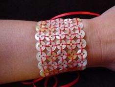 Button cuff. What if you made a longer one of these, attached elastic to the back and made it into a belt?