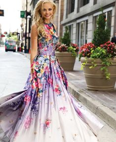Gorgeous purple prom dress 2015 by Jovani with stunning floral print, high neckline, open back and long flowy skirt