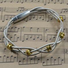 High Strung Studios - Braided Bass String Bracelet with Ball Ends, $38.00 (http://www.highstrungstudios.com/braided-bass-string-bracelet-with-ball-ends/)