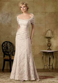 Dress features draped detail at waist, beading, and matching wrap. Also available in petite sizes 0-34.