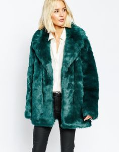 This teal faux fur coat is just too much... That colour though!
