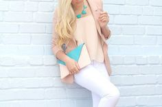 White pants , tan blouse, turquoise neckless