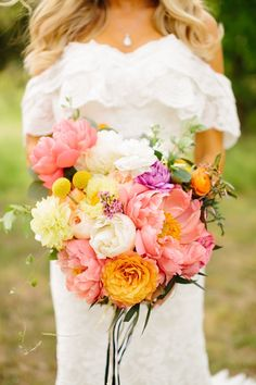 Pink and orange peony #bouquet Photography: Tucker Images - www.tuckerimages.com  Read More: http://www.stylemepretty.com/2014/08/05/colorful-boho-diy-wedding/