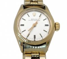 Rolex Lady's 14K Yellow Gold Wrist Watch  Lady's Rolex 14K Yellow Gold Oyster Perpetual Wrist Watch, ca. 1971-1983,  mechanical movement, with a silver dial and hash marks.    25mm case.  Item Number: WOO617