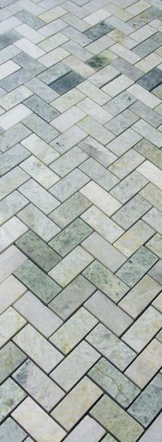 We've decided not to do a planned backsplash project so I am offering unused, new in box, 35 sq ft of polished ming green herringbone tile for $10/sq ft. Available for pick up near Brooklyn Co...