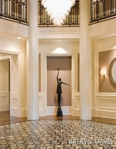 Incredible floor detail. Beautiful entrance  Brown Davis Interiors, Inc.