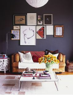 Interesting art grouping. Oh, and I love the wall color. Obsessed with gray/slate.