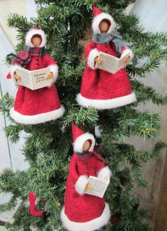 Christmas Caroler Ornament Handmade by ModerationCorner on Etsy... our Christmas Caroler is dressed in an old fashioned fur lined coat of red wool felt with black buttons along the front. Each one carries a miniature Christmas Carol book of actual carols shrunk to size and wears a wool scarf..