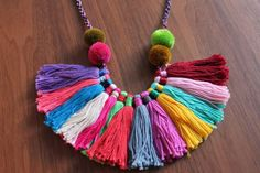 Aren't the colors amazing in this handmade boho tassel necklace by ChaipasbyJUBEL? The pom poms make it all the better.