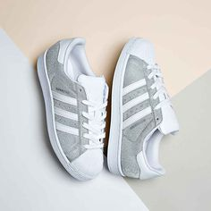 Treat yourself to the adidas Originals Womens Superstar Glitter Trainer. More styles available.