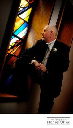 Michael ONeill Wedding Portrait Fine Art Photographer Long Island New York - Great Portrait of Groom by Stained Glass Church Window