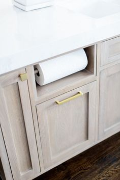 Built in paper towel holder. Kitchen island cabinet with Built in paper towel…