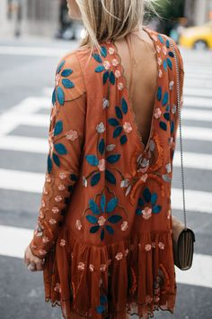 i am not a big orange girl but other than that i'm obsessed with this top. love the peek of back and the embroidery, as well as the loose peplum silhouette. if it was white or blue i'd wear it in a heartbeat.