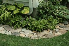 Love this rock border! Put down a weed barrier (cardboard, newspaper or weed blocking material) under rocks.