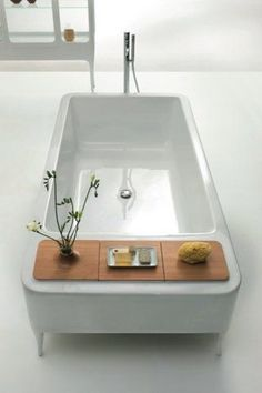 """Awesome Asian-style tub - a design that accommodates """"bathing for two"""" quite nicely.  :-)"""