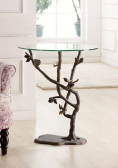 http://smithereensglass.com/bird-and-pinecone-end-table-p-267.html