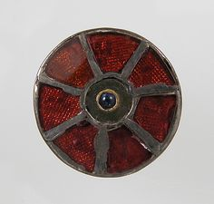Disk Brooch Date: 6th century Culture: Frankish Medium: Silver, glass paste or garnet, cabochon, metal foil, gold wire, niello?
