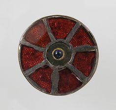 Disk Brooch  Date: 6th century Culture: Frankish Medium: Silver, glass paste or garnet, cabochon, metal foil, gold wire, niello?