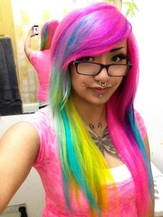 Not a fan of all the piercings but that is some COOL hair