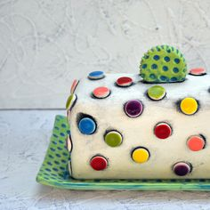 This colorful, whimsical butter dish is a unique art piece that just happens to hold butter! It is one of my favorite pieces to make in the studio.
