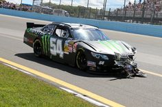 Kyle Busch wrecks during the first lap of the 2013 Zippo 200