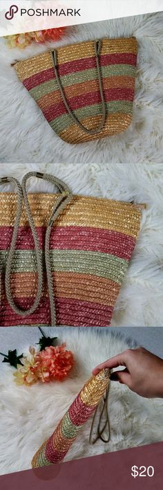 Red and Green Striped Straw Purse/Tote Beautiful straw bag with light red and mint green stripes. Straps are about 14.5 inches long, bag is about 9 inches wide on the bottom, about 20 inches on top. Height is about 15 inches, width is about 4 inches wide. There is also a pocket on the inside.  Thank you for looking and please check out my closet! Bags Totes