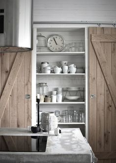 best of both worlds: open kitchen shelves and a barn door to close it off . Also concrete counter, natural wood - the style files Home, Home Kitchens, Indoor Sliding Doors, Kitchen Remodel, Kitchen Design, Kitchen Shelves, Open Kitchen Shelves, House Interior, Barn Doors Sliding