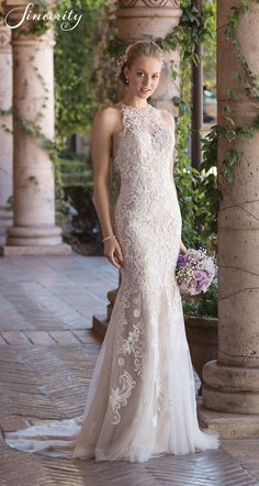 Style 4027: Stand out in this illusion Jewel neckline sweetheart wedding dress. Stretch lining forms the fit and flare silhouette with added Power Mesh for a body-sculpting, comfortable fit at the hip. Venice lace accents cover the gown inclusive of on the lace illusion racer back.