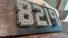 Instead of settling for store bought numbers you can make your own modern numbers using stainless steel screws.