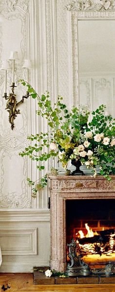 elegant French plaster and beautiful fireplace mantel and flowers French Interior, French Decor, Beautiful Interiors, Beautiful Homes, Interior And Exterior, Interior Design, Fireplace Mantels, Fireplaces, Mantles