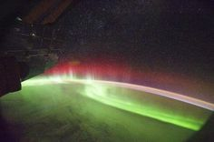 An image captured from the International Space Station taken shows a rare aurora appearing in red, September 26, 2011