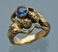 HENRI-ERNEST DABAULT Attrib. 'Zeus & Hera' Superb Art Nouveau Ring Gold Sapphire H: 1.7 cm (0.67 in) W: 2.2 cm (0.87 in) Ring Size: |UK:K| |US:5.25| |EU:50| |Asia:10| French, c.1902 Ring Case Literature: cf. The Paris Salons 1895-1914, Jewellery The Designers A-K, p. 165 Suitable as an engagement ring Dabault exhibited at the Universal Exposition, Paris, 1900 Ref: 7705
