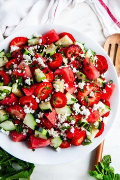 Watermelon Strawberry Cucumber Salad - The most refreshing 5 minute summer salad! Made with just 5 ingredients: watermelon, strawberry, cucumber, feta cheese and mint. From aberdeenskitchen.com #summer #salad #vegetarian #strawberry #watermelon #cucumber #fetacheese #mint #sidedish #bbq