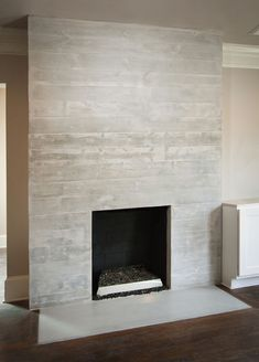 white washed concrete planks fireplace