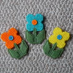 Plastic Canvas Flower Magnets set of 3 by ReadySetSewbyEvie, $4.50 -- Now sewn in new colors! I can do custom colors, as well! magnet set, flower magnet, plastic canva