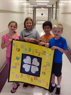 Students finished the center of the paper CritterKin Kindness quilt! It looks great!