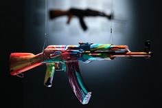 """Damien Hirst: """"Spin AK47 for Peace One Day"""" 