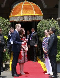 Looking glamorous: Kate is expected to showcase a number of Indian designers with her choice of outfits during the couple's tour, but she played it safe with one of her favourite fashion houses for the country's first sight of her