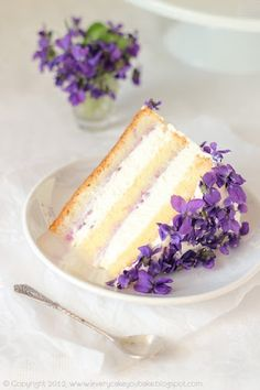 Violet cake...these violets would be gorgeous on any cake