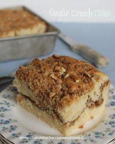 Sugar Crumb Cake Rezept: Mehl,Backpulver,Zucker,gewürfelt,Eier,Milch,Extrakt,Zucker,Mehl,geschmolzen,Pekannüsse,Zimt