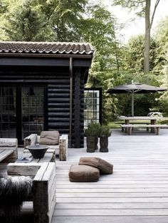 This log cabin with a beautiful black exterior, this looks like an amazing spot to relax and enjoy life.