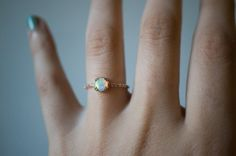Brushstroke Opal Solitaire Ring with Pavé Band & Secret Diamond by S. Kind & Co.