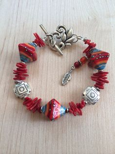 SoWestern bracelet with colorful Lampwork beads, coral sticks and silver beads.