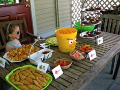 great angry birds party food ideas: served VERY angry birds (chicken nuggets) and VERY naughty piggies (bacon-wrapped hot dogs), pigs in a blanket, deviled eggs, worms and grubs (gummy worms and slugs), goldfish, bird's nest cookies and bird seed (snack mix).