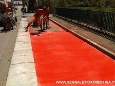 Realizzazione pista ciclabile in vernice rossa