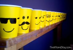 Lego cups and make Lego man heads by sticking little marshmallow to big marshmallow and dipping in yellow colored white chocolate