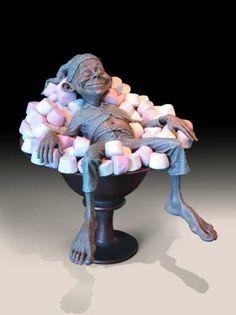Bronze Sculpture of Children by artist David Goode titled: 'Comfort Food (bronze David Goode Imp garden Goblin sculptures)'